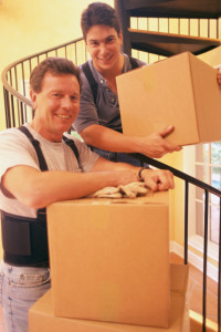 two men are moving packages